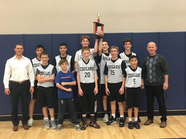 Covenant Christian School Christian Athletic League of Orange County champions hoist the trophy: in back are Coach Josh Vandenberg, Sean Fan, Josh Azucena, Kyan McCarville, Ethan Hanning and Alexis Laine; in front are Jeffrey Johnson, Matteo Laine, Cade McCarville and Mark Johnson, Caleb Azucena, and Coach Tom Daley. (Courtesy Covenant Christian School)
