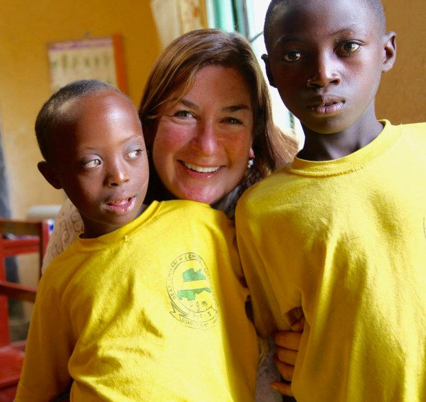 Julie Virjee, wife of Cal State Fullerton president Fram Virjee, visits children at the Fair Children Deaf School in Rwanda, one of several projects the couple support in Rwanda. (Photo courtesy of Julie Virjee)