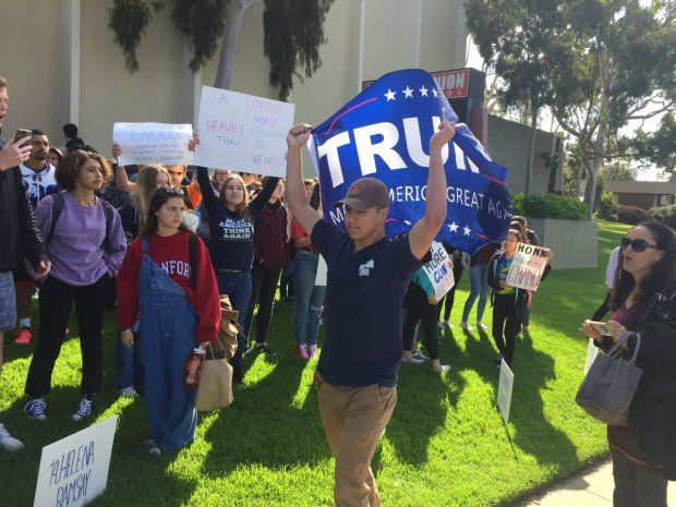 "Students at Redondo Union High School gathered on a lawn on campus at Pacific Coast Highway and Diamond Street. Amid the anti-gun protesters was a Trump supporter with a ""Make America Great Again"" banner."