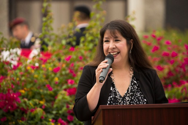 Catherine Ward, interim director of Cal State Fullerton's Veterans Resource Center, is seen speaking at a Veterans Month morning colors ceremony. (Photo courtesy of Cal State Fullerton)