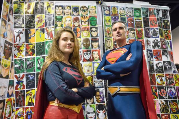 Rory Dawson, 14, and her father, Shane Holly, cosplay as Superman and Supergirl during WonderCon in Anaheim on Friday, Mar 23, 2018. (Photo by Jeff Gritchen, Orange County Register/SCNG)