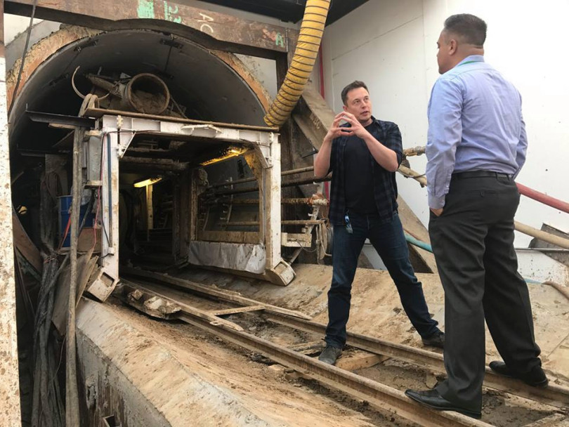 Elon Musk and Hawthorne Mayor Alex Vargas inside of The Boring Co. tunnel entrance at the company's initial tunnel project in Hawthorne