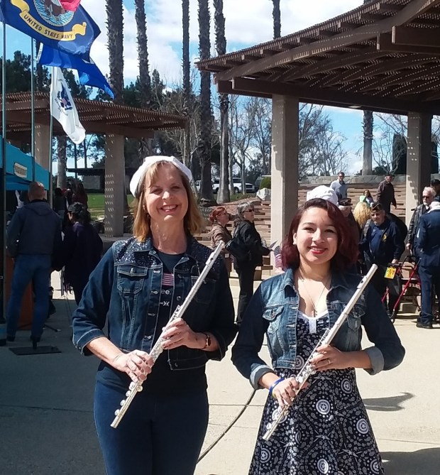 Judy Hanlon and Sarah Calderilla, both of Riverside, prepare to play their flutes at the Welcome Home, Vietnam Veterans Day program at Riverside National Cemetery on March 24. (Photo courtesy of Laura Calderilla)