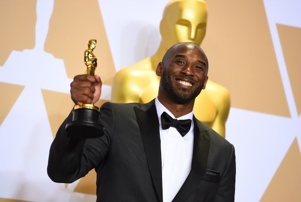 "Kobe Bryant, winner of the award for best animated short for ""Dear Basketball"", poses in the press room at the Oscars on Sunday, March 4, 2018, at the Dolby Theatre in Los Angeles. (Photo by Jordan Strauss/Invision/AP)"
