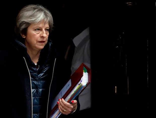 Britain's Prime Minister Theresa May leaves 10 Downing Street to attend the weekly Prime Minister's Questions session, in parliament in London, Wednesday, March 14, 2018. The Kremlin says Russia rejects the deadline that Britain gave it to explain any involvement in the poisoning of an ex-Russian spy. (AP Photo/Frank Augstein)