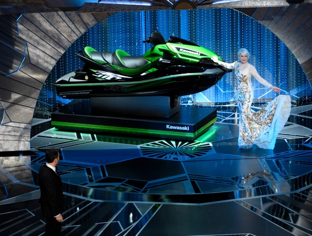 Helen Mirren displays a jet ski as host Jimmy Kimmel looks on, left, at the Oscars on Sunday, March 4, 2018, at the Dolby Theatre in Los Angeles. (Photo by Chris Pizzello/Invision/AP)