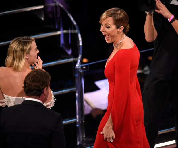 """Margot Robbie, left, reacts as Allison Janney wins the award for best performance by an actress in a supporting role for """"I, Tonya"""" at the Oscars on Sunday, March 4, 2018, at the Dolby Theatre in Los Angeles. (Photo by Chris Pizzello/Invision/AP)"""