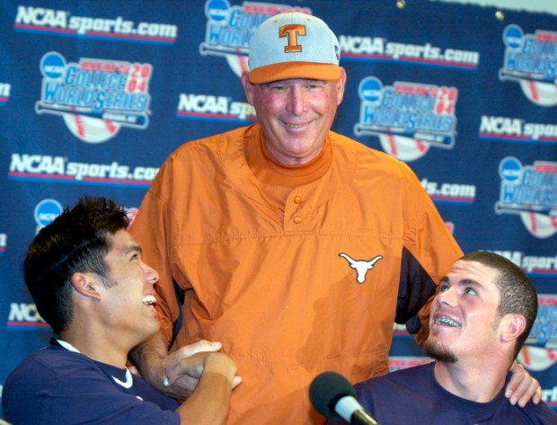 Texas coach Augie Garrido, center, jokes with Cal St. Fullerton catcher Kurt Suzuki, left, and pitcher Jason Windsor, at a news conference in Omaha, Neb., Friday, June 25, 2004. Texas and Cal State Fullerton begin their best-of-three College World Series championship series on Saturday. (AP Photo/Nati Harnik)