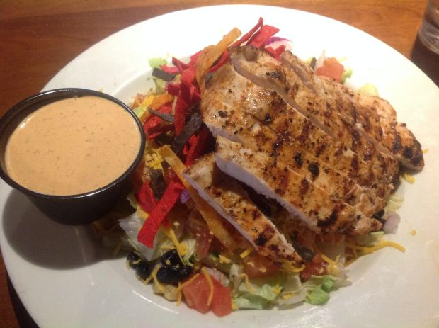 The Station Taphouse Southwest Chicken Salad contained a generous portion of chicken breast and a large assortment of vegetables with tortilla chips and a spicy ranch dressing. (Photo by Dorene Cohen)