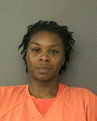 In this handout photo provided by the Waller County Sheriff's Office, Sandra Bland poses for a mug shot at the County Jail July 10, 2015 in Hempstead, Texas.