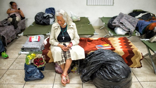 Mary Serano sits on her cot in an emergency shelter at the Greater Missionary Baptist Church on Norris Ave. in Pacoima. (Photo by Hans Gutknecht, Los Angeles Daily News/SCNG)