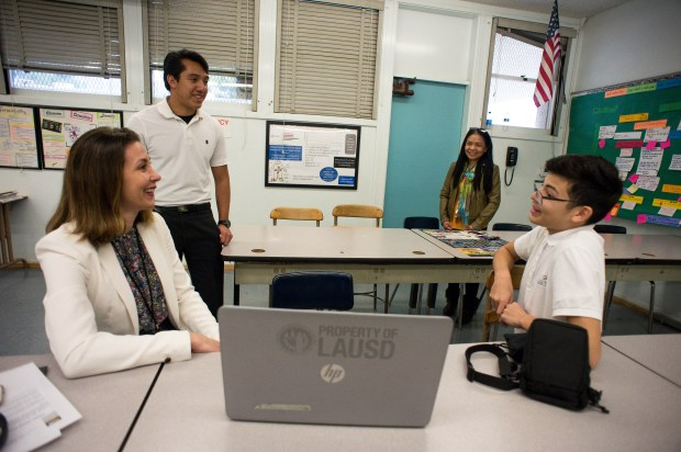 Silvana Caruana, a community engagement coordinator for the Los Angeles Homeless Services Authority (LAHSA), meets on Wednesday, March 14, 2018 with students Joel Yahutentzi, left, and Brian Hernandez, both 16, who designed Safe-Way, a tracking system for information about the homeless and services, with another student Jonathan Pe–a at Sylmar Biotech Health Academy on Wednesday, March 14, 2018. The students plan to continue the award winning database project to help with homelessness in their community. Their engineering instructor Edna Losa, second from right, also attends the meeting. (Photo by Sarah Reingewirtz, Pasadena Star-News/SCNG)