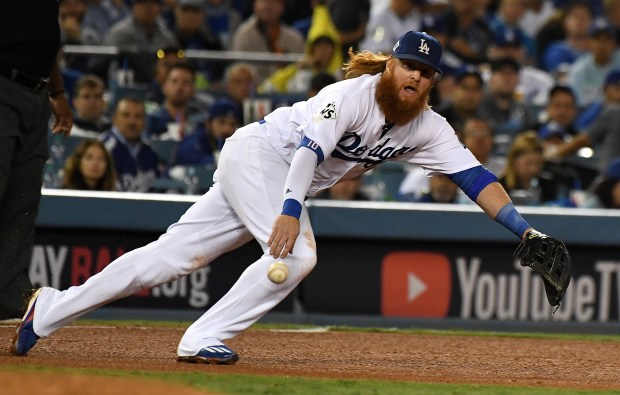 Los Angeles Dodgers third baseman Justin Turner dives for the ball but is unable to come up with the single by Houston Astros' Marwin Gonzalez (not pictured) in the 4th inning of game seven of a World Series baseball game at Dodger Stadium on Wednesday No