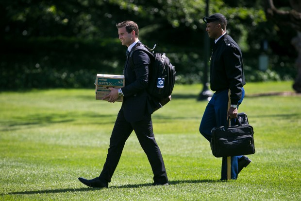 John McEntee, President Donald Trump's personal aide, walks to Marine One on the South Lawn of the White House in Washington, June 9, 2017. McEntee, who has served as President Trump's personal assistant since Trump won the presidency, was forced out of his position and escorted from the White House on March 12, 2018, after his security clearance was revoked, officials with knowledge of the incident said. (Al Drago/The New York Times)
