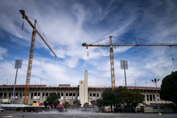 Work is well underway at USC's $270 million renovation project at the Coliseum. With an emphasis on local hires, construction firm Hathaway Dinwiddie will bring as many as 2,000 on board over the next two years. (Photo by David Crane, Los Angeles Daily News/SCNG)