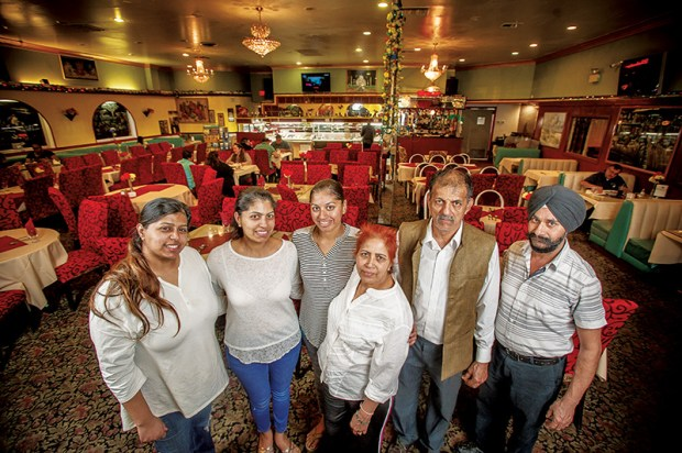 Punjab Palace Cuisines of India in Riverside family: Sonia, Meenu, Yashmeen, Mamta and Ashok Sharma and Gurmukh Singh, right,  Feb. 9, 2018.  (Eric Reed/For Riverside Magazine/SCNG)