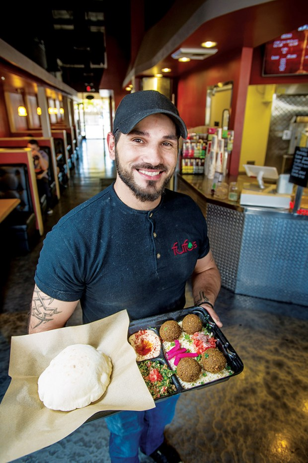 Fufu's Co-owner Hassan Chararah holds a falafel plate at Fufuís Mid East Grill And Hookah in Riverside. Feb. 16, 2018.  (Eric Reed/For The Riverside Magazine/SCNG)