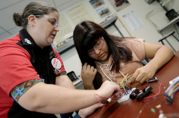 Instructor Kat Panowicz helps Arisai Palma, 14, make an electro magnet during hands-on trade and professional skills class at Learn4Life and Vocademy on Friday, March 23.Photo by Terry Pierson, The Press-Enterprise/SCNG