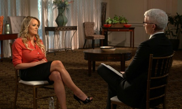 """This image released by CBS News shows Stormy Daniels, left, during an interview with Anderson Cooper which will air on Sunday, March 25, on """"60 Minutes."""" (CBS News/60 Minutes via AP)"""