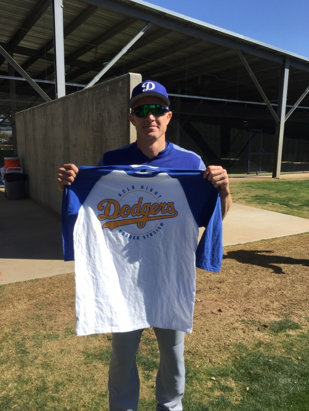 A UCLA shirt, as shown by second baseman Chase Utley, will be offered Friday when the Dodgers host the Cincinnati Reds. (Photo courtesy of the Dodgers)