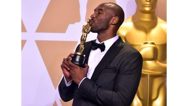 "Kobe Bryant poses in the press room with the Oscar for Best Animated Short Film for ""Dear Basketball,"" during the 90th Annual Academy Awards on March 4, 2018, in Hollywood, California. / AFP PHOTO / FREDERIC J. BROWN (Photo credit should read FREDERIC J. BROWN/AFP/Getty Images)"