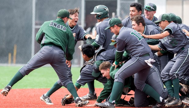 South Hills' Brandon Dieter, in helmet, is swarmed by teammates after delivering the game-winning hit in the bottom of the seventh inning during an opening round game of the Boras Classic at Mater Dei in Santa Ana on Tuesday, April 3, 2018. (Photo by Mindy Schauer, Orange County Register/SCNG)