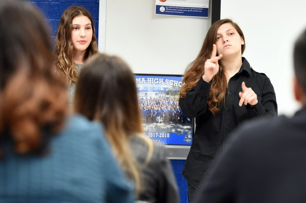 Alta Loma High School senior Danielle Sanchez (right) uses sign language as sophomore Makayla Sateri (left) reads aloud as they take part in the American Sign Language (ASL) Wednesday April 4, 2018 in Rancho Cucamonga. (Photo by Will Lester, Inland Valley Daily Bulletin/SCNG)