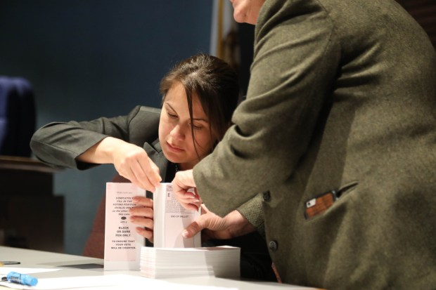 Ballots are sorted by Karla Rangel a Palos Verdes Estates intern Tuesday night April 10, 2018 at City Hall. Photo by Charles Bennett