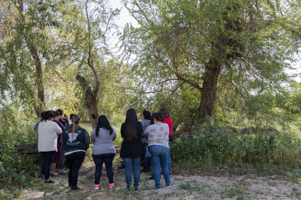 Family and friends of Jeremy Sanchez pray at the site where his body was found near the Emerald Necklace river trail in South El Monte, Calif. on Thursday April 19, 2018.  (Photo by Raul Romero Jr, Contributing Photographer)