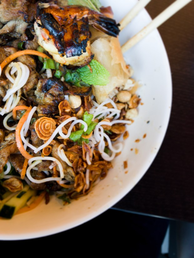 Bún (rice vermicelli noodles) topped with grilled shrimp, grilled pork, fried garlic, fresh mint, chives, carrots and cucumber at Simply Pho in Orange. (Photo by Brad A. Johnson, Orange County Register/SCNG)