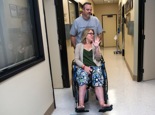 Lisa and Joel Wittenberg say goodbye as they leave Lisa's doctor's office in Orange on Monday, April 2, 2018. (Photo by Mindy Schauer, Orange County Register/SCNG)