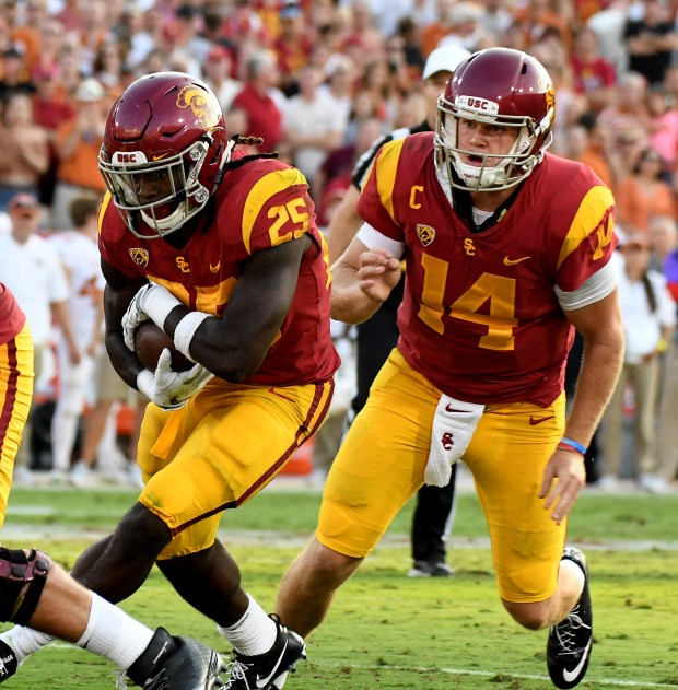 USC Trojans quarterback Sam Darnold (14) hands off to teammate running back Ronald Jones II (25) against the Texas Longhorns during a NCAA college football game at the Los Angeles Memorial Coliseum in Los Angeles, on Saturday, Sept. 16, 2017. USC Trojans won in double over-time 27-24. (Photo by Keith Birmingham, Pasadena Star-News/SCNG)