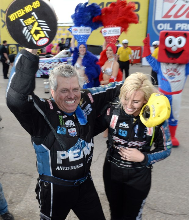 Funny Car winner John Force (left) celebrates with his daughter Courtney after defeating her in the finals at the NHRA Toyota Nationals at The Strip at Las Vegas Motorspeedway Sunday October 30, 2016 while Antron Brown clinched his third Top Fuel title. (Will Lester-SCNG/Inland Valley Daily Bulletin)
