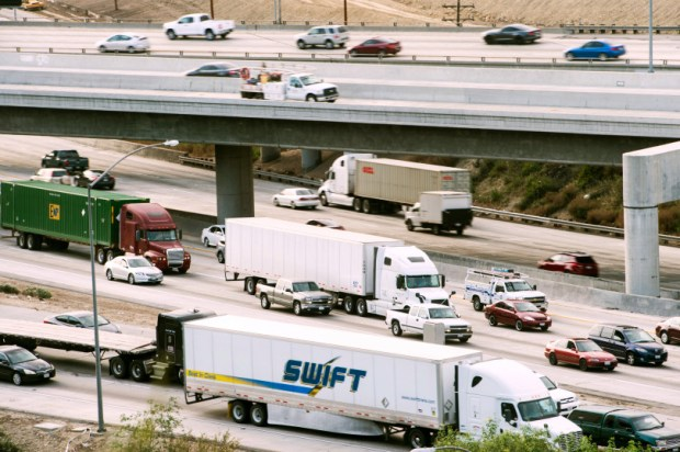 Traffic flows through the interchange of the 60 and 57 freeways in Diamond Bar on Wednesday, March 18, 2015. (Photo by Watchara Phomicinda/ San Gabriel Valley Tribune)