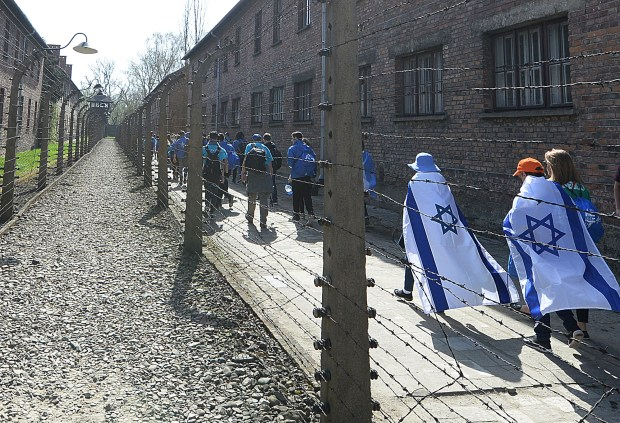 A group of Israeli youth visit the former Nazi German death camp of Auschwitz ahead of the yearly March of the Living, a Holocaust remembrance march, in Oswiecim, Poland, on Thursday  April 12, 2018.(AP Photo/Czarek Sokolowski)