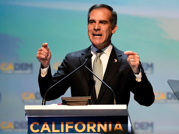 In this Feb. 24, 2018 photo, Los Angeles Mayor Eric Garcetti speaks at the 2018 California Democrats State Convention in San Diego. Garcetti, like other Democratic mayors considering the presidential race in 2020, is hoping to show party activists that his experience running a city can preview success on the national scene. He planned to make his debut in Iowa on April 13, talking to union carpenters, seeing representatives from the Asian, Latino and LBGTQ communities and headlining a county party dinner. (AP Photo/Denis Poroy, File)