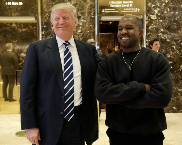 Then President-elect Donald Trump and Kanye West pose for a picture in the lobby of Trump Tower in New York, Tuesday, Dec. 13, 2016. (AP Photo/Seth Wenig)