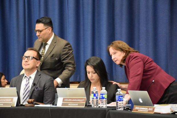 Shown at Tuesday's Azusa School Board meeting are School Board member Paul Naccachian, seated left; Board President Helen Jaramillo, center; and Superintendent Linda Kaminski, right.Photo by Julia Wick, contributing photographer.