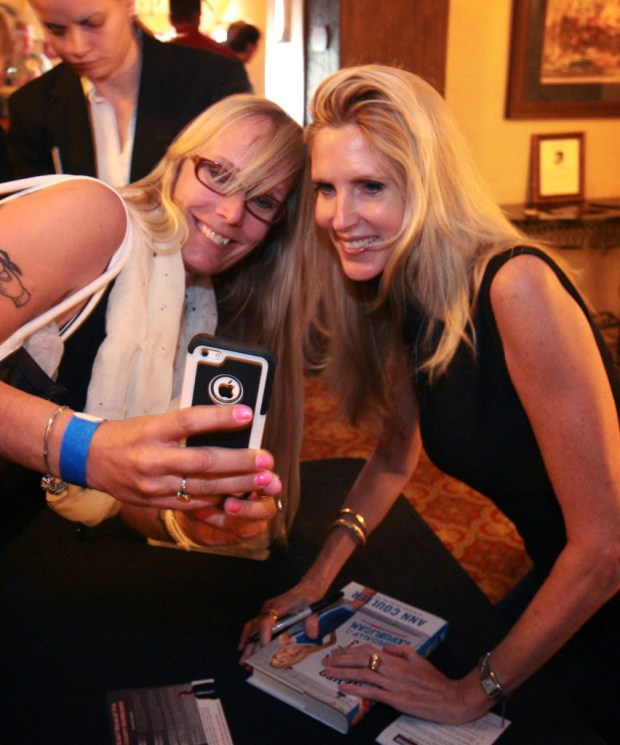 Conservative commentator Ann Coulter, right, poses for a photo at the 2014 Unite Inland Empire Conservative Conference in Riverside (File photo by David Bauman, The Press-Enterprise/SCNG).