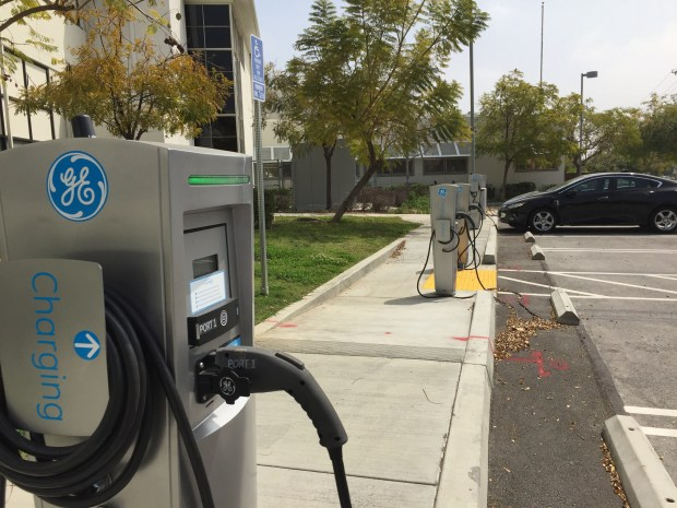 Seven electric charging ports are working in the front parking lot of Rosemead High School on Mission Drive. The portals are free and open to the public. (Photo by Steve Scauzillo)