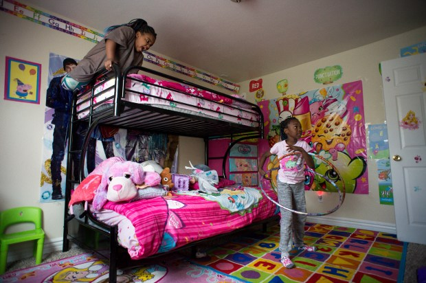 Jaimya Gant, 5, and her sister Joshshawn, 7, play in the bedroom of their Los Angeles home on Thursday, April 19, 2018. The two lived in a car with their mother and two siblings in Watts before finding a home through a Los Angeles County program that offers incentives to landlords who take in homeless people with Sec. 8 or VASH vouchers. (Photo by Sarah Reingewirtz, Pasadena Star-News/SCNG)