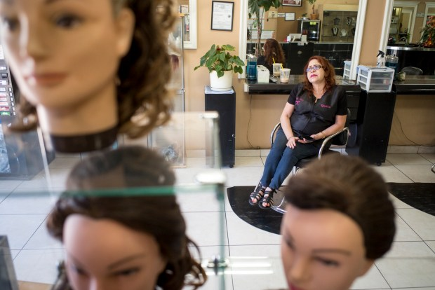 Queta Botero of Toque Nuevo beauty salon on San Fernando road says that business has dropped since the closing of the JC Penny store in San Fernando. ( Photo by David Crane, Los Angeles Daily News/SCNG)