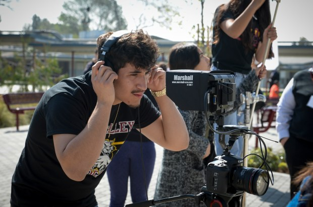 Steve Pavon, a senior, checks the sound for a video segment produced by students in the Film Production program at Sun Valley High School. ( Photo by David Crane, Los Angeles Daily News/SCNG)