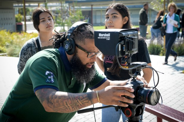 Dr. Jamal Speakes helps students get set for a video segment produced by students in the Film Production program at Sun Valley High School. The school opened the doors on it's $500,000 studio and editing facility funded by a Career Technical Education Incentive Grant. ( Photo by David Crane, Los Angeles Daily News/SCNG)