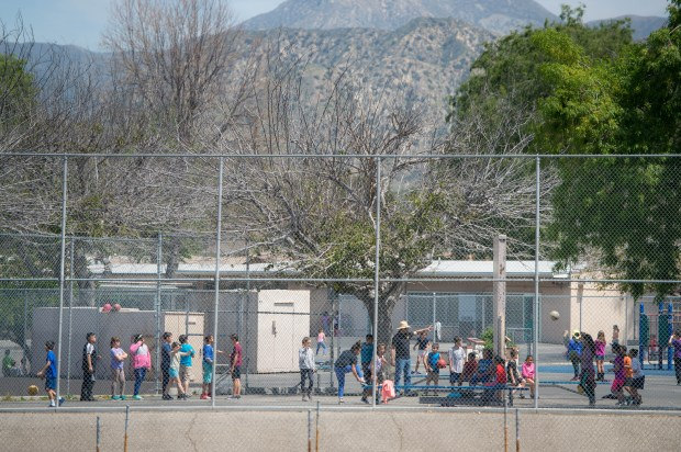 Children play at Sunland Elementary School in Sunland-Tujunga on Tuesday, April 10, 2018. The school is adjacent to Sunland Neighborhood Church where Verizon has proposed to install a 30-foot cellphone tower in the parking lot . A petition that seeks to stop the project has collected more than 100 signatures. (Photo by Sarah Reingewirtz, Pasadena Star-News/SCNG)