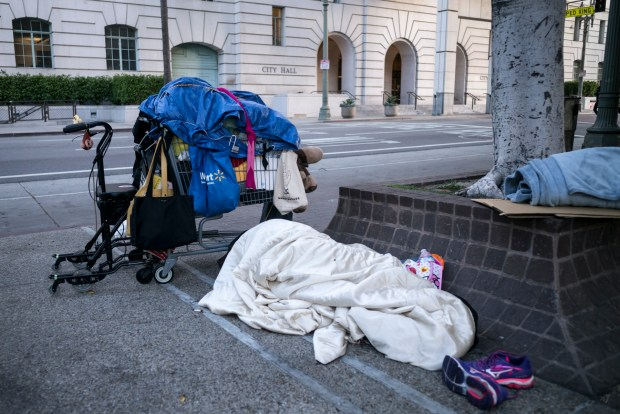 On the morning of the State of the City address presented by Mayor Eric Garcetti at Los Angeles City Hall, on Monday, April 16, 2018, homeless begin waking up along Main street at adjacent to City Hall. (Photo by David Crane, Los Angeles Daily News/SCNG)