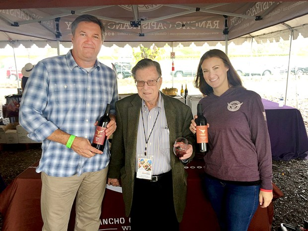 Joel Fisher, center, with Rancho Capistrano Winery owners.