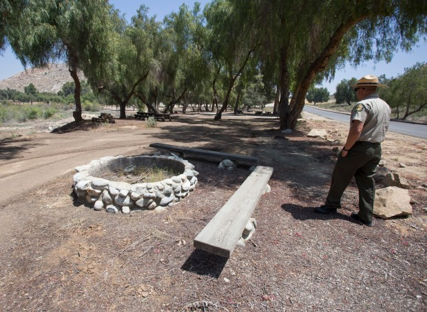 John Rowe, state park superintendent for the Perris Sector, walks Friday, April 27, through one of three camping areas near the Bernasconi Beach at the Lake Perris State Recreation Area that are open again.Photo by Andrew Foulk, contributing photographer