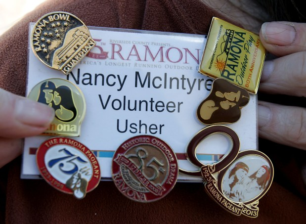 Volunteer Usher Nancy McIntyre has collected a number of pins in her more than 50-years of volunteering for the Ramona Pageant . (File photo by Terry Pierson, The Press-Enterprise/SCNG)