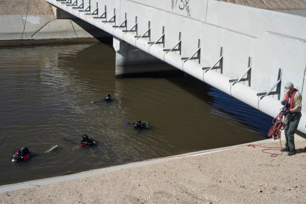 San Bernardino County Sheriff's dive team prepare to enter the California Aqueduct in Hesperia to continue the search for Noah Abbot, 2, Friday, March 3, 2017. The boy's body was recovered days later. A March 2, 2017 car crash into the aqueduct left the boy's mother, Christina Eileen Estrada, 31, and one his brothers, Jeremiah Robert Abbott, 3, both of Hesperia, dead and injured another brother, Elijah Estrada, 10. (File photo by Sarah Alvarado, for The Sun/SCNG)